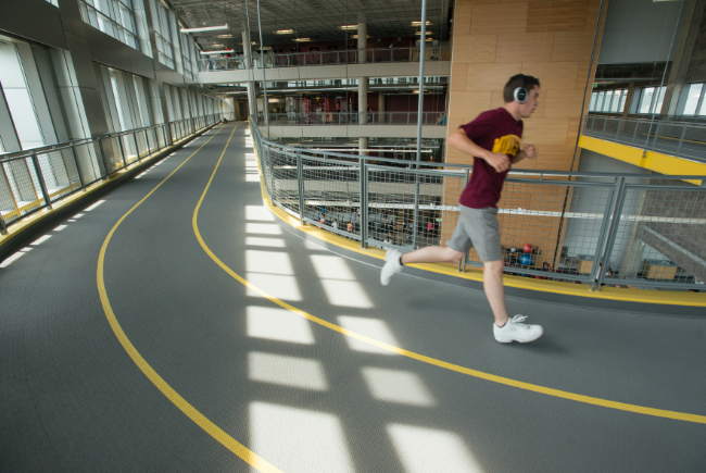 student running on the track at the Minneapolis rec center