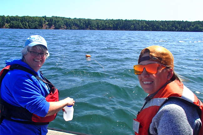 Photo of U of M researchers collecting water samples.
