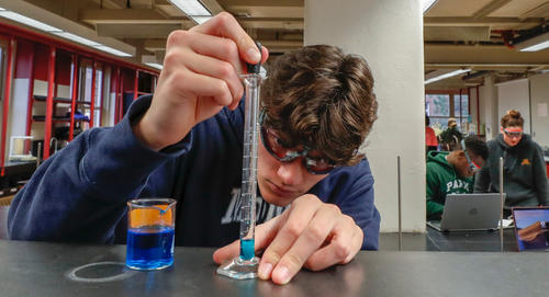 Student working in science lab