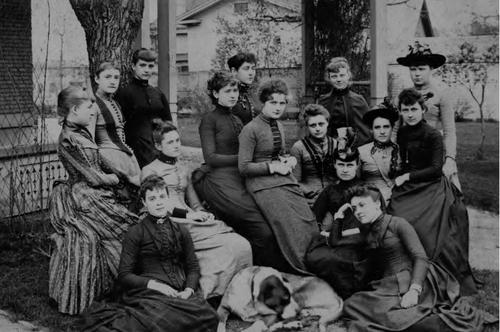 female students posing in black and white photo from early years of the University