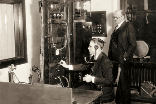 Student working an early electronic switchboard