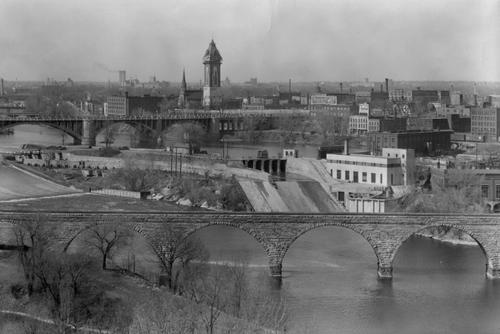St. Anthony Falls lab with Stone Arch bridge in foreground, as seen in early 1900s