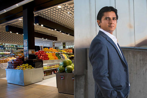 grocery store produce area next to photo of Karthik Natarajan