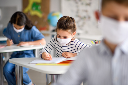 Students wearing a mask in a classroom.