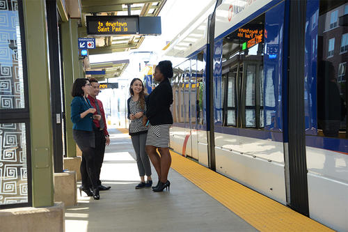 women at a metro transit stop