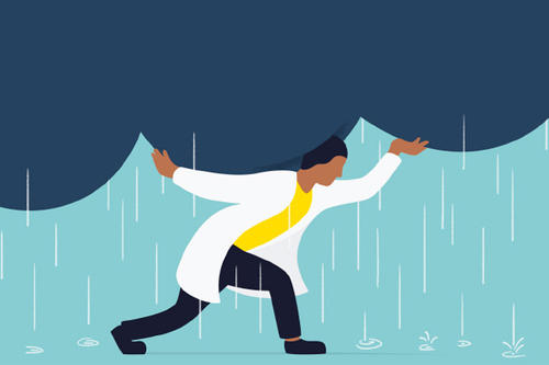 A graphic shows a male medical student in white coat bent over, laboring carry a heavy cloud.