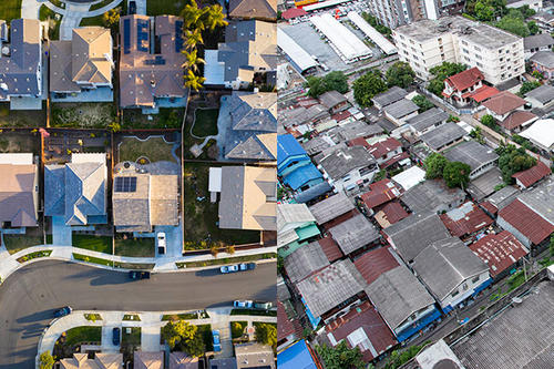 An overhead view of two diverse neighborhoods of housing.