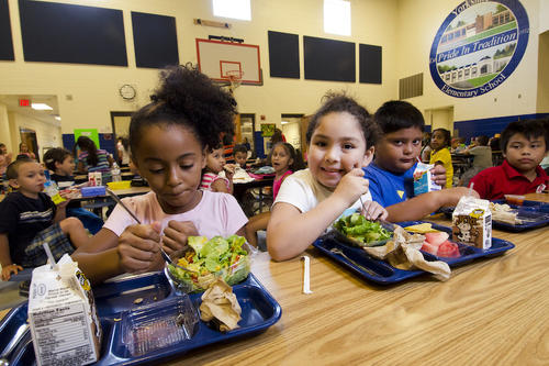 Elementary school kids eating lunch in cafeteria