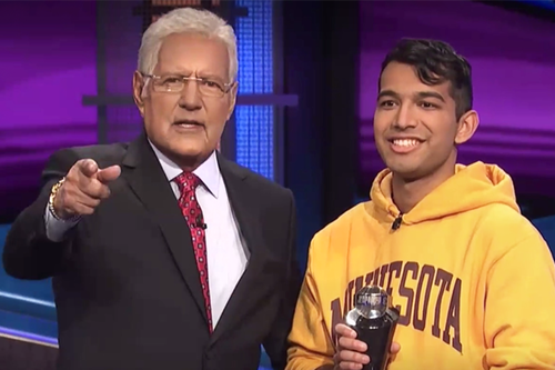 Jeopardy host Alex Trebek stands with College of Science and Engineering student Nibir Sarma.