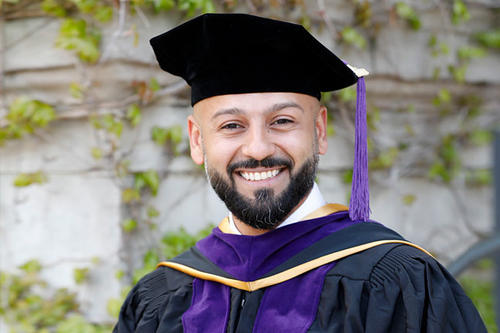 Mohammed Al Mulhim, bearded, in graduation cap.