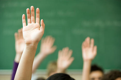 Students raising their hands