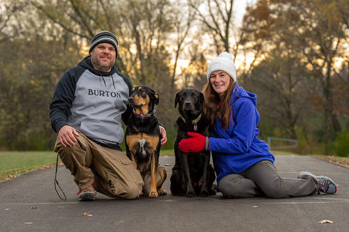 Chris and Jill Carter with their labradors, Holly (left) and Rudy. Photo by Steve Woit.